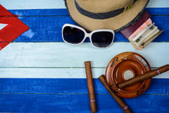 Cuban cigars and ash tray on flag. Cuban cigars and ash tray on national flag Royalty Free Stock Images