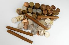 Cuban cigars with coins isolated on white Stock Images