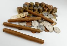 Cuban cigars with coins isolated on white Royalty Free Stock Photos