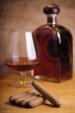 Cuban cigars and french cognac Stock Photography