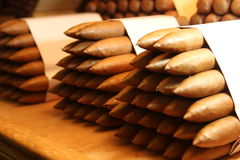 Cuban cigars in a large pile inside a humidor Stock Photo