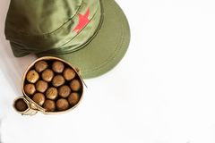 Cuban cigars rolled in banana leaf and military cap. Some Cuban cigars rolled in banana leaf and military cap stock image
