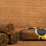 Cuban cigars on wooden background royalty free stock image