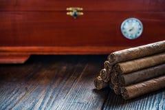 Cuban cigars and wooden humidor Stock Images