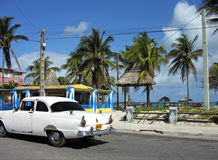 Cuban Classic. Old American classic car on the a seaside road. Varadero, Cuba royalty free stock photography