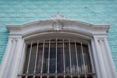 Cuban colonial architecture decorations in vintage house window. The window has iron work for protection and beauty royalty free stock photo