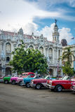 Cuban colorful vintage cars in front of the Gran Teatro - Havana, Cuba. Cuban colorful vintage cars in front of the Gran Teatro in Havana, Cuba royalty free stock images