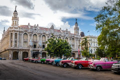 Cuban colorful vintage cars in front of the Gran Teatro - Havana, Cuba. Cuban colorful vintage cars in front of the Gran Teatro in Havana, Cuba royalty free stock photography