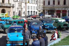 Cuban communal taxis. Square in Havana, Cuba with parked communal taxis, solution to the shortage of vehicles Stock Photo