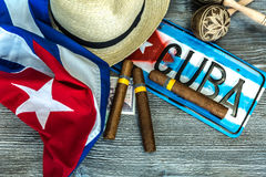 Cuban concept table of some related items.  Royalty Free Stock Photo