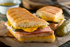 Cuban Cubano Sandwich. An authentic cuban sandwich on pressed medianoche bread with pork, ham, cheese, pickle, and mustard Stock Image
