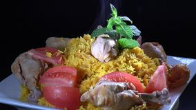Cuban Cuisine: Rice with Chicken or Arroz con Pollo stock footage