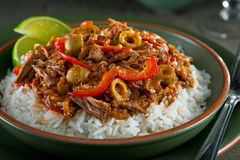 Cuban Cuisine, Ropa Vieja. A delicious cuban ropa vieja stew on a bed of rice with lime garnish Royalty Free Stock Photography