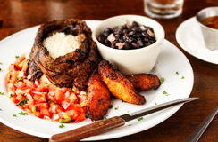 Cuban Cuisine. Of steak, black beans, rice, plantains, and salsa royalty free stock photography