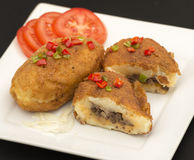 Cuban cuisine: traditional stuffed potatoes Royalty Free Stock Images