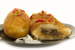 Cuban cuisine: traditional stuffed potatoes Stock Photography