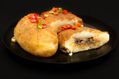 Cuban cuisine: traditional stuffed potatoes Stock Images