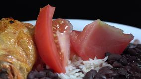 Cuban Cuisine: White rice and black beans soup with chicken stock video footage