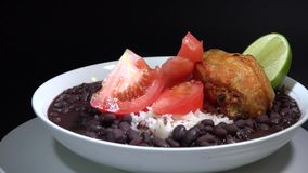 Cuban Cuisine: White rice and black beans soup with chicken stock video