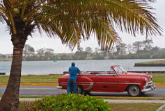 Cuban driver and his car Royalty Free Stock Images
