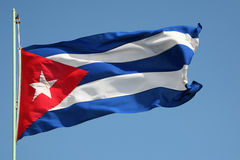 Cuban Flag. Cuban national flag on the blue sky Stock Photo