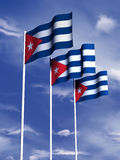 Cuban flag. The flag of Cuba flies in front of a blue sky royalty free illustration