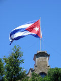 Cuban Flag in the breeze. Giant Cuban flag flying in the breeze of a blue sky day in Havana Stock Photo