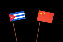 Cuban flag with Chinese flag  on black Royalty Free Stock Images