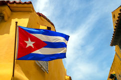 Cuban Flag and Colonial Buildings. Cuban flag set against blue sky and yellow colonial buildings Stock Photography