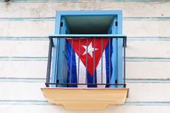 Cuban flag displayed in the colonial stylish window stock photo