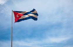 Cuban flag flying in the wind on a backdrop of blue sky. Royalty Free Stock Image