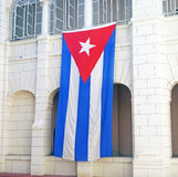 Cuban flag hangs from the Museo de la Revolucion Royalty Free Stock Photos