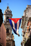 Cuban flag in Havana. Cuban flag hanging between buildings in Havana, Cuba Stock Photography
