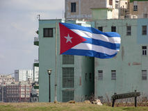 Cuban flag in Havana Cuba. Cuban flag against an apartment building in Havana, Cuba Stock Images