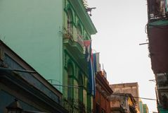 Cuban flag on the house. Street scene with traditional colorful buildings in downtown Havana. Cuba. Old Havana District royalty free stock photos