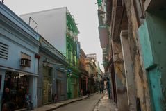Cuban flag on the house. Street scene with traditional colorful buildings in downtown Havana. Cuba. Old Havana District stock images