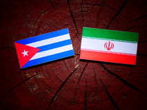 Cuban flag with Iranian flag on a tree stump isolated. Cuban flag with Iranian flag on a tree stump Royalty Free Stock Photos