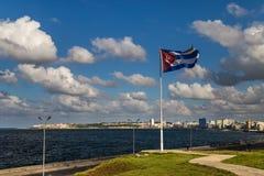 Cuban flag. Over El Malecon promenade, Havana royalty free stock photo