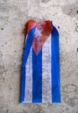 Cuban flag over eroded surface Royalty Free Stock Photo
