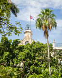 Cuban flag. In the picture the Cuban flag placed on a bell tower in the center of Havana Royalty Free Stock Photos
