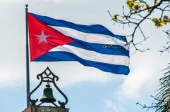 Cuban flag in Plaza de las Armas, Havana, Cuba. Cuban flag moving on top of a church in Plaza de las Armas square in Havana, Cuba stock image