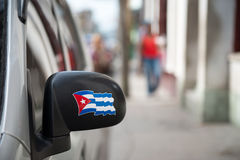 Cuban Flag in the rearview mirror of a car Royalty Free Stock Image
