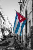 Cuban flag in a shabby street in Havana Stock Photo