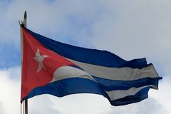Cuban flag on sky. Cuban flag in old Havana Royalty Free Stock Images