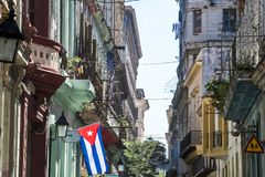 Cuban flag in street of Havana. View over balconies and cuban flag in street of Havana Royalty Free Stock Image