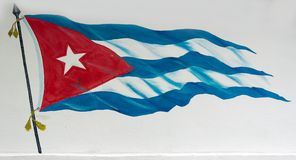 Cuban Flag in a street wall. Cuban flag painted in white wall, creative and beautiful drawing of the Cuba's flag tied to a flagpole with a white background Royalty Free Stock Image