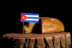Cuban flag on a stump with bread. Isolated Royalty Free Stock Image