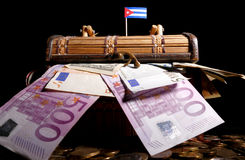 Cuban flag on top of crate. Full of money Royalty Free Stock Image