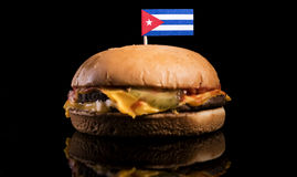Cuban flag on top of hamburger isolated on black Stock Images