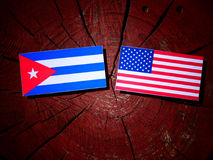 Cuban flag with USA flag on a tree stump  Stock Photo
